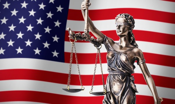 Themis with scale, symbol of justice on USA flag background
