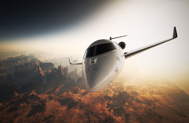 Photo White Glossy Luxury Generic Design Private Jet Flying in Sky under Earth Surface.Grand Canyon Background Sunrise. Business Travel Picture.Horizontal,Front View.Film Effect. 3D rendering.