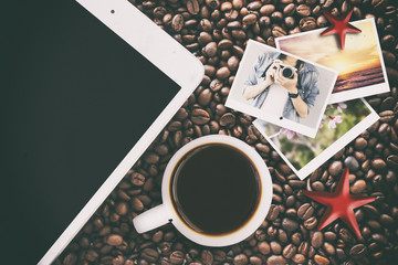 tablet computer and photograph with coffee beans background