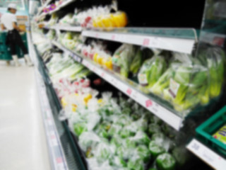 Blur of fresh vegetables on shelf in supermarket