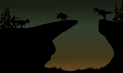 Silhouette of Triceratops and Allosaurus