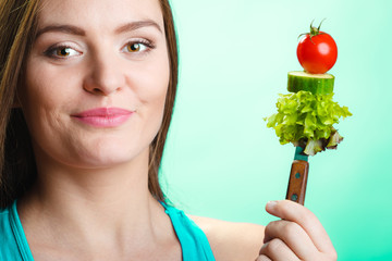 Attractive woman holding healthy food.