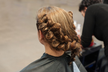 Bride doing hair at the morning in Wedding day