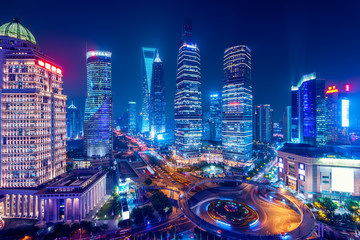 Night view of Lujiazui.  Since the early 1990s, Lujiazui has been developed specifically as a new financial district of Shanghai.
