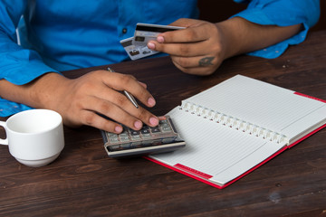 Man analyzing his payment by credit card. accounting.