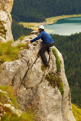 Climbing Man with Lake of Crno Jezero on Bacground, Durmitor, Mo
