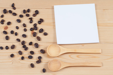 strong roasted coffee beans on grunge  wood