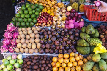 colorful tropical fruits on display in the market