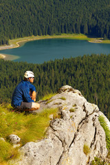 Watching Tourist with Lake of Crno Jezero on Background, Durmitor, Montenegro