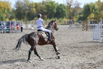Competitor in show jump taking her course