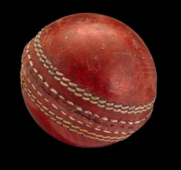 Old worn Cricket Ball isolated on Black Background
