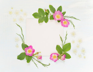 Scrapbook page with wild roses and white flowers