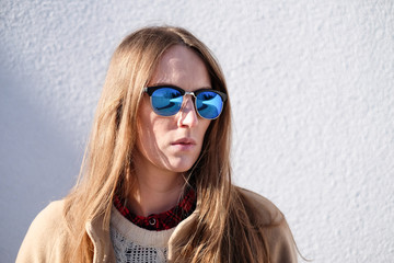 Portrait of a woman wearing sunglasses