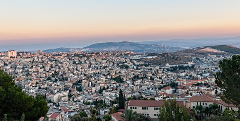 Sunset over city, Nazareth, Israel