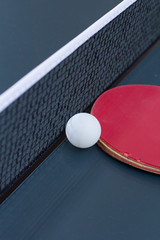 Ping Pong: composition of old scratched racket with grid and ball