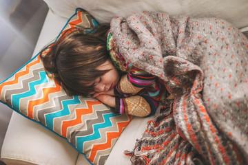 Girl sleeping on sofa