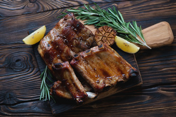 Freshly baked pork ribs in a rustic wooden setting