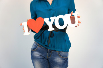 """The girl with the sign """"I love you"""""""