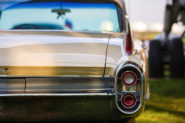 Back view of classic vintage car. Old retro car. Classic vintage car. Shallow depth of field. Selective focus.