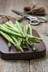 fresh asparagus on a cutting board