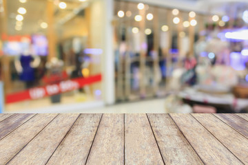Empty table and blur clothing store with bokeh background