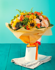 Colorful bouquet of flowers in a white jug