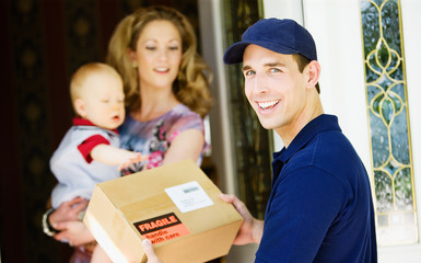 Delivery: Cheerful Man Delivering Package to Home