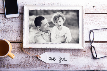 Fathers day composition. Picture of father with son in frame