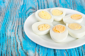 Boiled hen eggs in a white plate