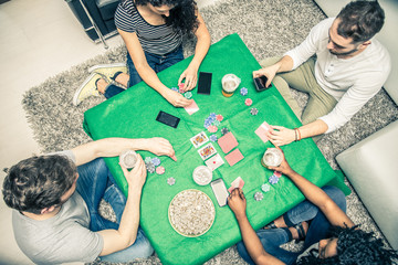 Friends playing poker at home