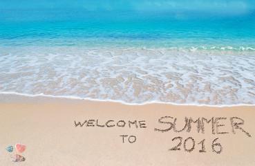 welcome to summer 2016 written on a tropical beach