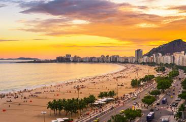 Sunset view of Copacabana beach and Avenida Atlantica in Rio de Janeiro, Brazil