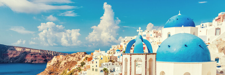 Aluminium Prints Santorini Three Domes church panoramic view of Santorini island, Oia village, Greece. Famous Europe travel european destination greek island. Horizon landscape banner crop for advertisement copyspace.