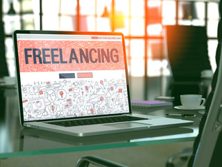 Freelancing Concept. Closeup Landing Page on Laptop Screen in Doodle Design Style. On Background of Comfortable Working Place in Modern Office. Blurred, Toned Image. 3D Render.