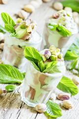 Pistachio ice cream with mint, dessert, served in glasses, vinta