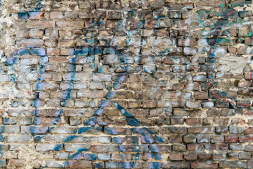old dirty and grainy brick stone city underground wall with all kind of different color textures urban style background