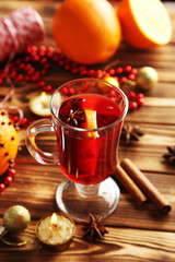Mulled wine in glass on brown wooden table