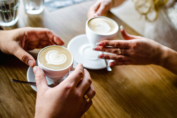 man and woman hands. love and cup coffee concept