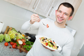Adult guy having healthy lunch