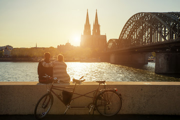 Young romantic couple spending their vacation in Cologne, German