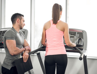 Treadmill walk with personal trainer.