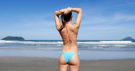 Brazilian Woman enjoying a summer day in beach, Brazil