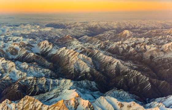 aerial of the mountains in Tashkent, china and Kirgistan, covere