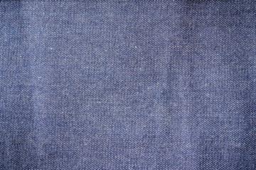 Blue denim jeans closed up texture.