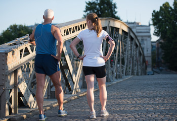 jogging couple planning running route  and setting music