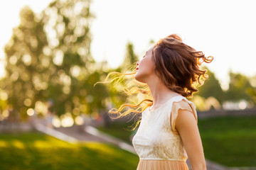 Girl at sunset with flying hair