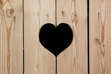 Light beige wooden background with a heart. Vintage texture. Wooden background.