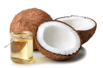 cut the coconut and coconut oil in a small glass jar on a white isolated background