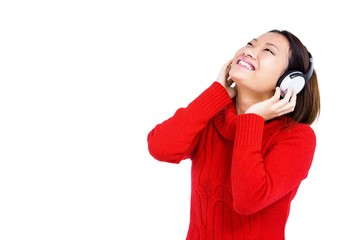 Young woman listening to music on headphone