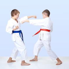 Boys beat punch arm toward each other